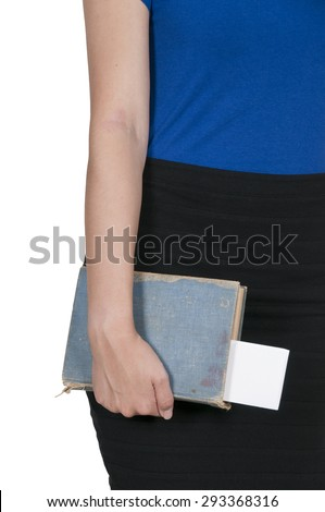 Beautiful woman holding a library book - stock photo