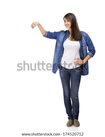 Beautiful woman holding and showing something over a white background - stock photo