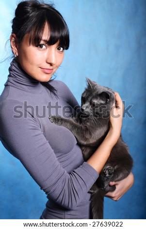 Beautiful woman holding cat - stock photo