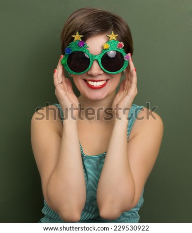 Beautiful woman holding Christmas party glasses