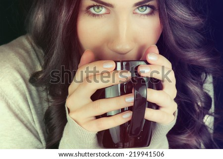 Beautiful woman holding cup of tea.