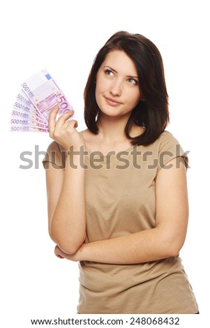 Beautiful woman holding euro cash money in hand and thinking looking to tht side at blank copy space, over white background - stock photo