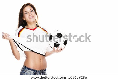 beautiful woman holding football pulling her football shirt on white background - stock photo