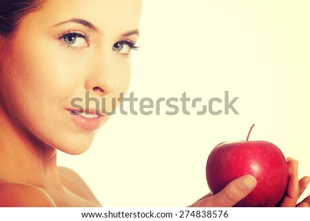 Beautiful woman holding fresh apple