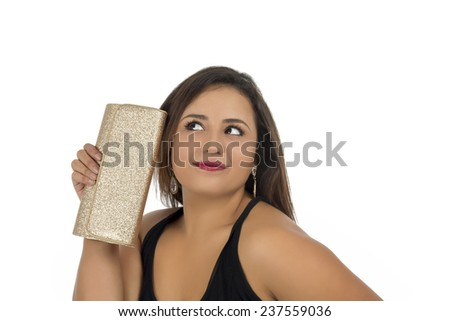 Beautiful woman holding gold glitter purse against a white background - stock photo