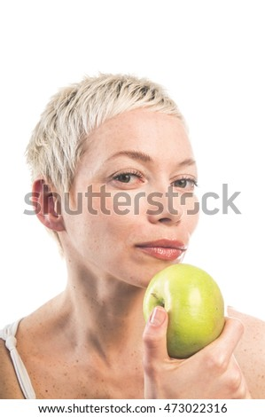 Beautiful woman holding green apple on white background