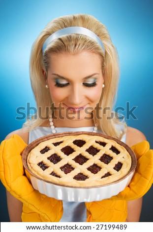 Beautiful woman holding hot italian pie. Retro stylized portrait - stock photo