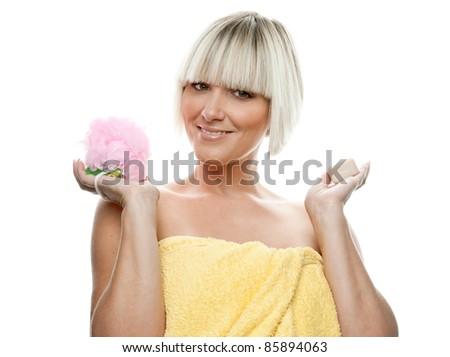 beautiful woman holding pink sponge and soap - stock photo