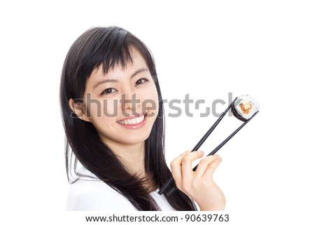 beautiful woman holding sushi with chopsticks, isolated on white background - stock photo