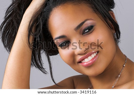 beautiful woman holding up her hair