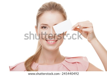 Beautiful woman holding white card with copy space.  Isolated. - stock photo