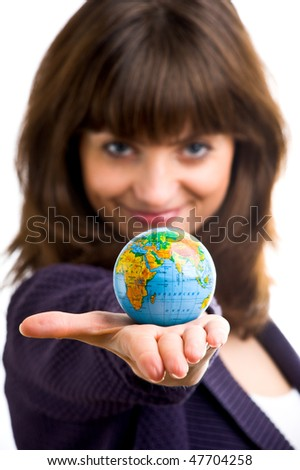 Beautiful woman holds the globe in hand. It is isolated on a white background
