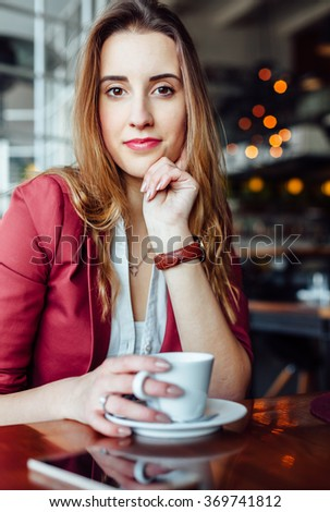 Beautiful woman in a cafe