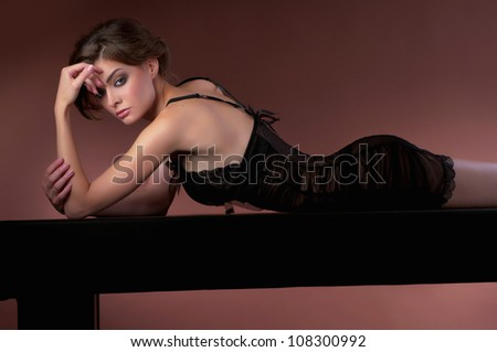 beautiful woman in a dark dress on the table