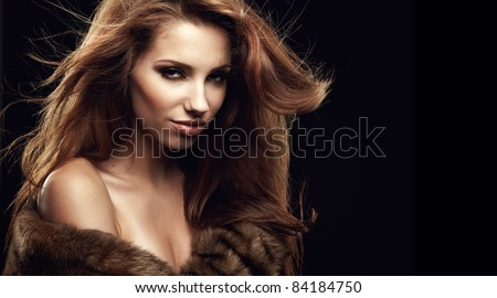 beautiful woman in a fur coat