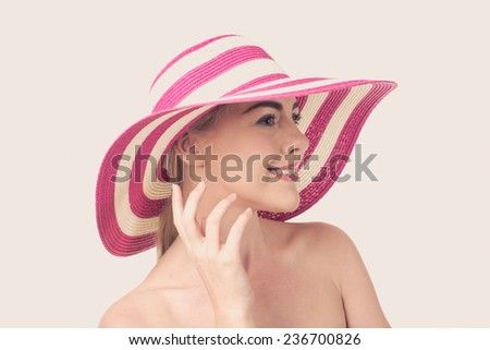 Beautiful woman in a hat - stock photo