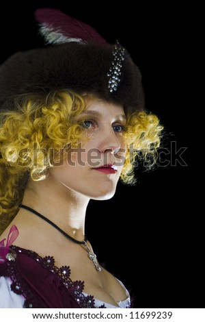 Beautiful woman in a hat with feather