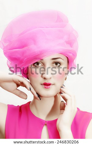 Beautiful woman in a pink hat and dress