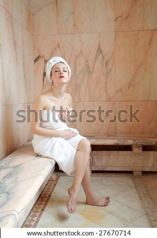 beautiful woman in a sauna - stock photo