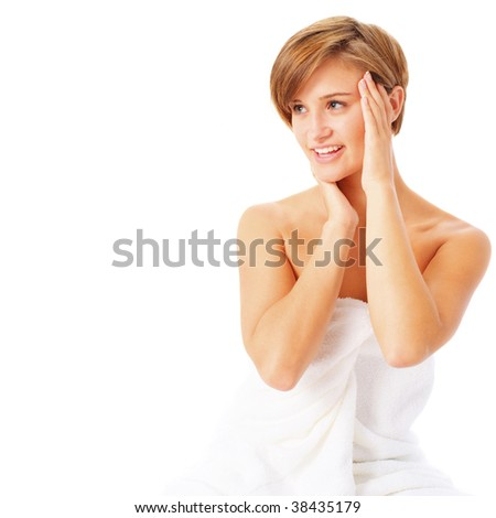 Beautiful woman in a towel touching her face, from a complete series of images.