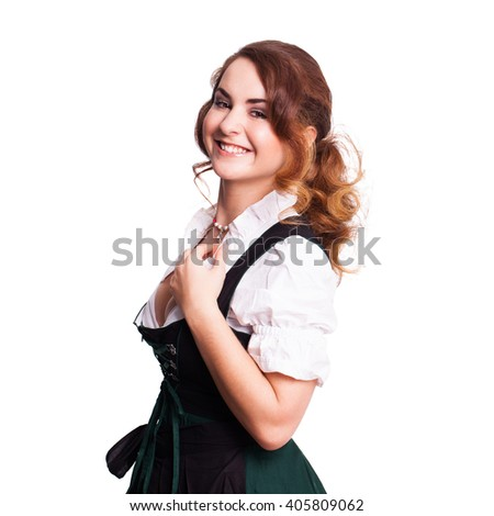 beautiful woman in a traditional bavarian dirndl isolated on white - stock photo