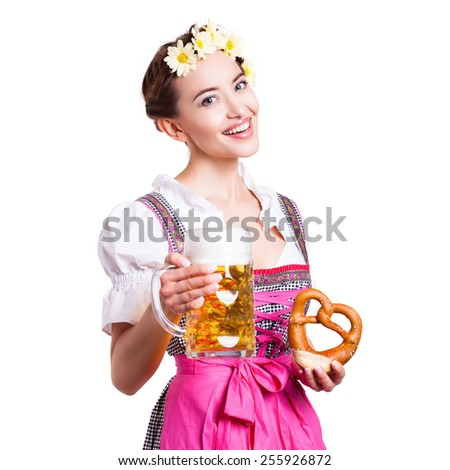 beautiful woman in a  traditional bavarian dirndl with beer and pretzel