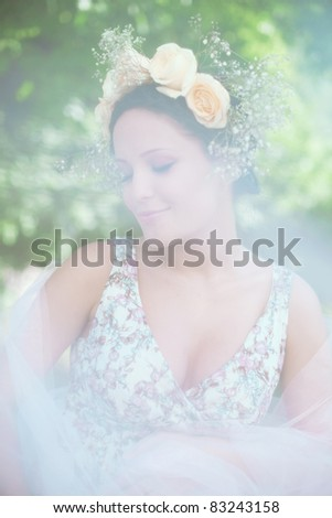 Beautiful woman in an outdoor - stock photo