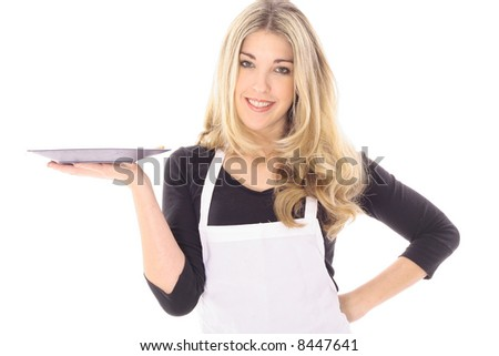 beautiful woman in apron holding your product - stock photo