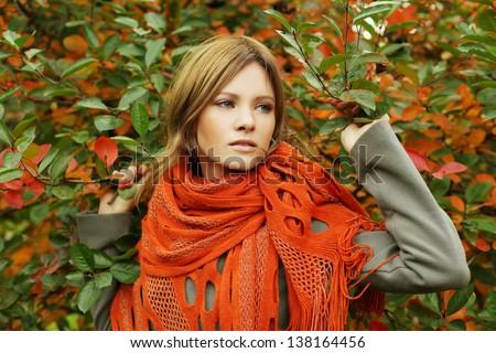 Beautiful woman in autumn foliage, fashion portrait - stock photo