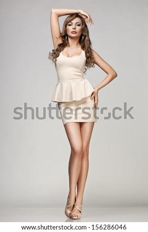 beautiful woman in beige dress - stock photo