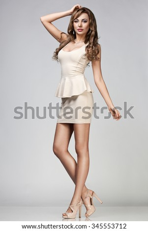 beautiful woman in beige dress - stock photo