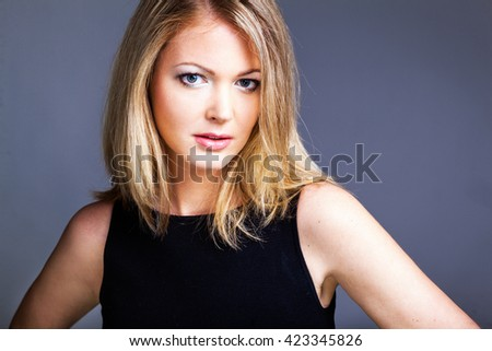 Beautiful woman in black classical dress pose in studio