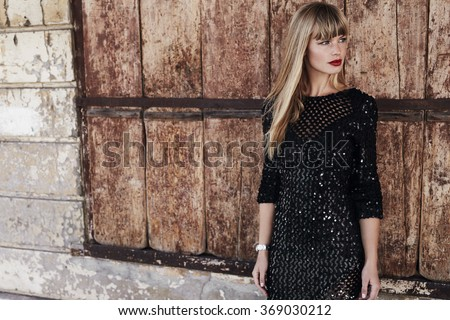 Beautiful woman in black dress, looking away