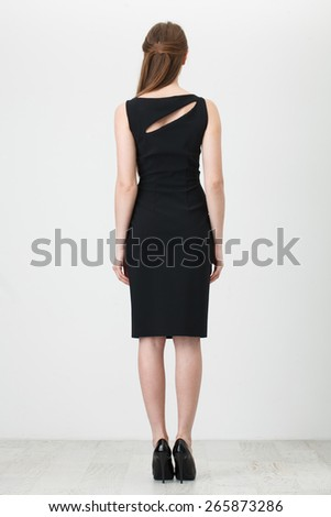 Beautiful Woman in Black Dress on White - stock photo