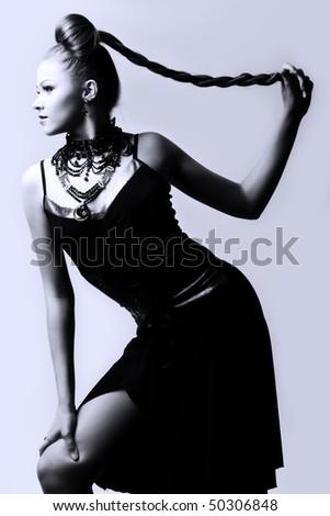 beautiful woman in black evening dress - stock photo