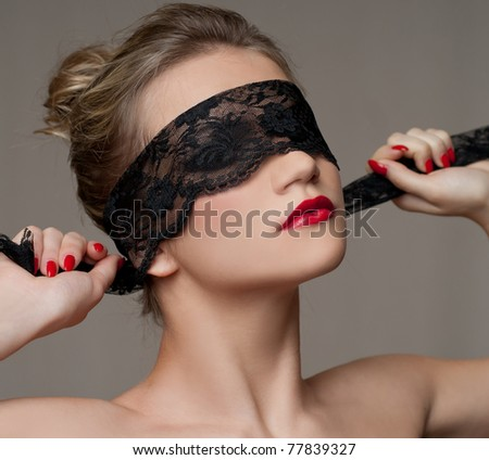Beautiful Woman in Black Lace - stock photo
