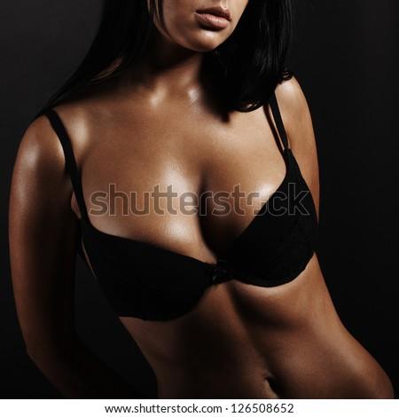 Beautiful woman in black underwear. real breast - stock photo
