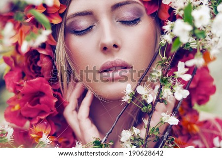 Beautiful woman in blooming orchard - stock photo