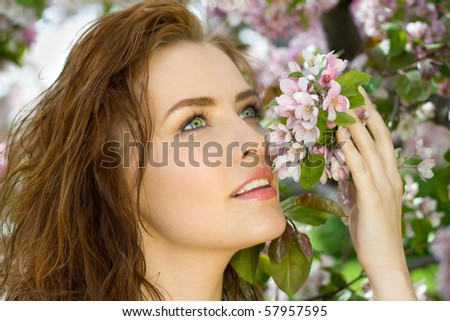 beautiful woman in blossom orchard