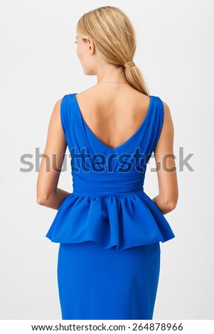Beautiful Woman in Blue Dress on White - stock photo