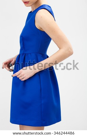 Beautiful Woman in Blue Dress on White Background