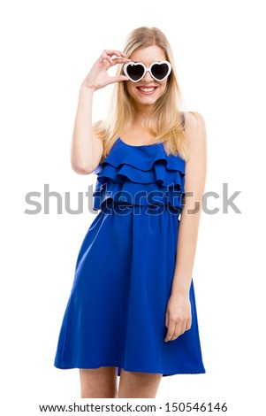 Beautiful woman in blue dress using sunglasses, isolated over white background - stock photo