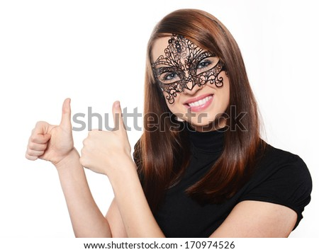 Beautiful woman in carnival mask over white background - stock photo