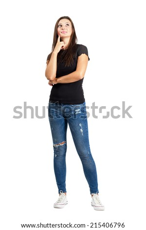 Beautiful woman in casual clothes thinking. Full body length isolated over white. - stock photo