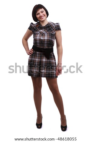 Beautiful woman in checkered dress. A young and attractive female standing on white background