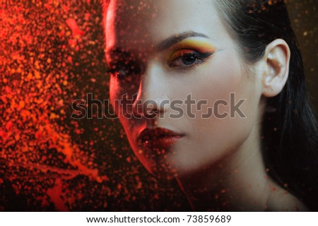 beautiful woman in color spray - stock photo