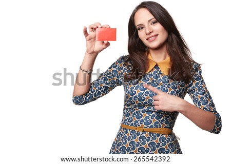 Beautiful woman in colorfull dress holding empty credit card and pointing at it,  isolated on white - stock photo