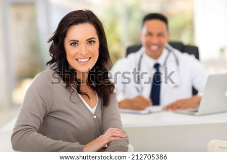 beautiful woman in doctor's office for checkup - stock photo