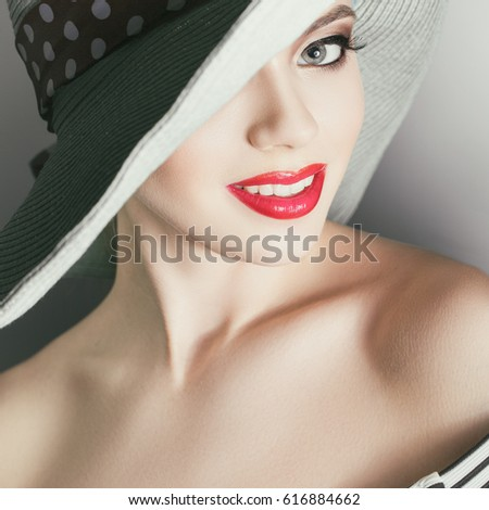 beautiful woman in elegant hat with a smile on his face