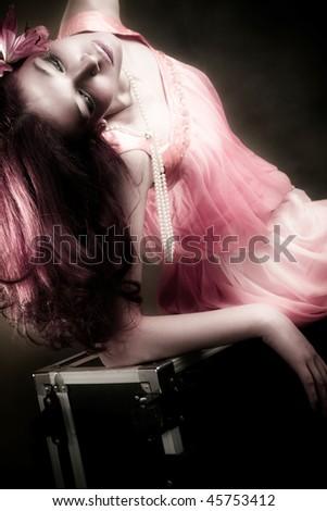 beautiful woman in elegant pink dress, posing, studio shot - stock photo